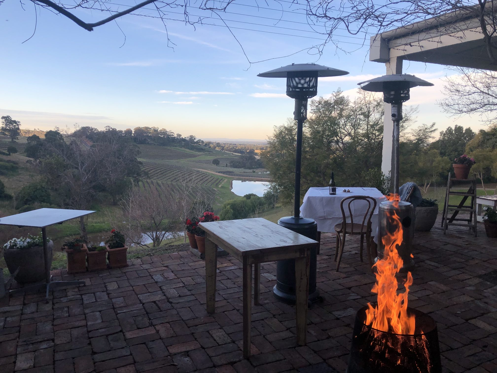 Open fire, looking out over vineyards in the valley below.