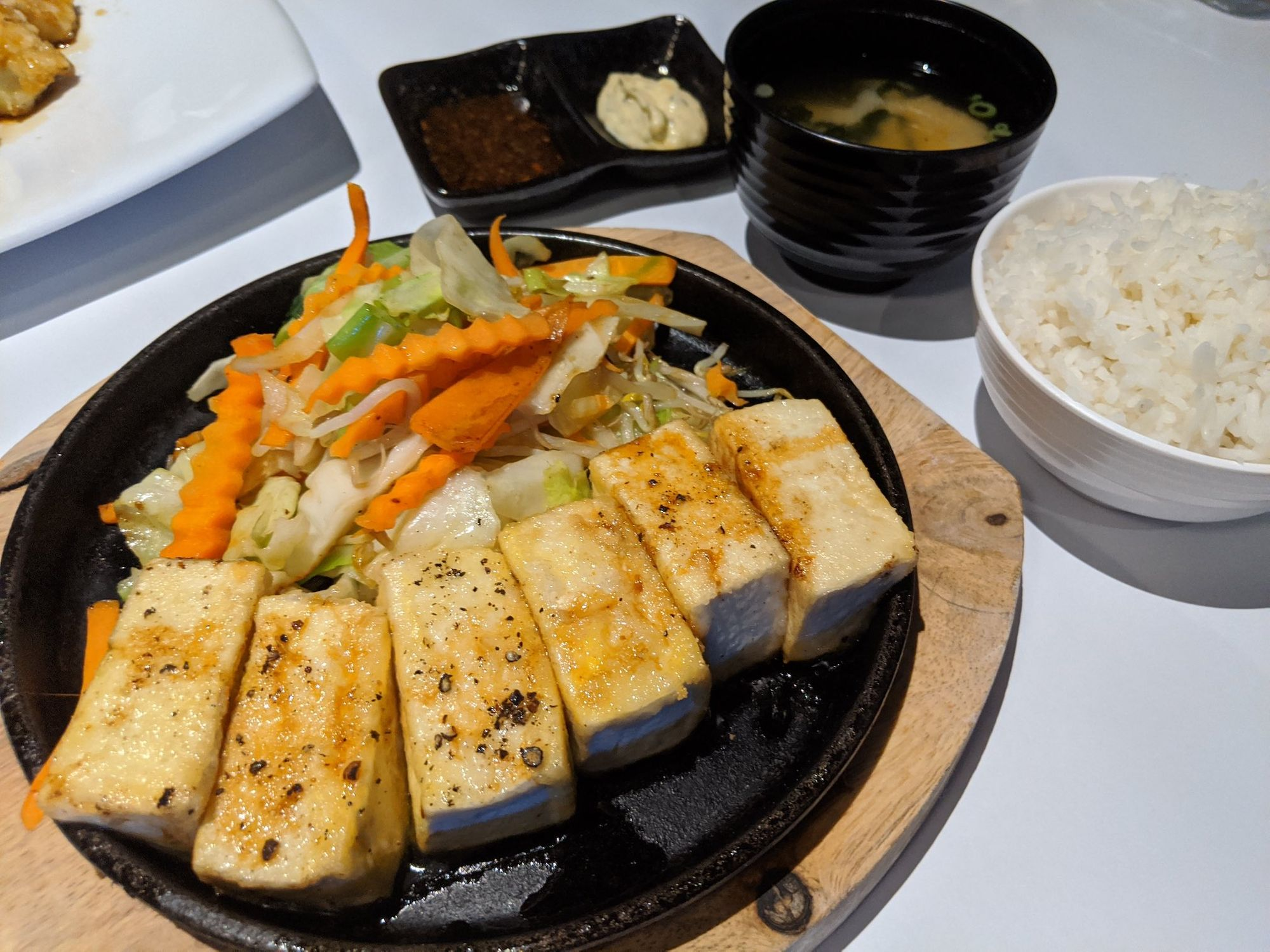 Tofu, veges on hotplate, with side of rice.